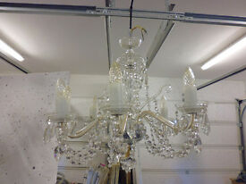 Three crystal chandeliers