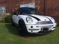 Mini Cooper wrapped in gloss white 12mot swap what you got