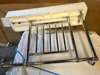 Heated electric towel rails