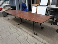 Folding boardroom table with rosewood finish