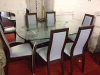 Lovely glass dinning table with six lovely high back dinning chairs for sale