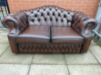 A Dark Brown Leather Chesterfield Two Seater Settee