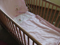 Cot bed, birth to 5 years, with sheet, duvet & fleece. Excellent condition (owned by grandparents)