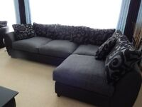 Excellent condition, comforable, Black and Grey corner sofa unit with footstool come coffee table..