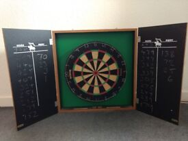 Winmau dartboard and cabinet, in good condition