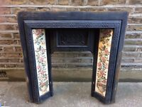 Solid Cast Iron Victorian fireplace surround with original tiles.