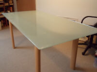 Beautiful large opaque glass top dining table.