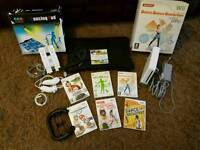 Nintendo Wii with balance board games and dance mats