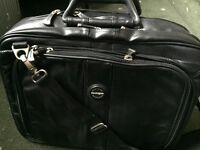 Expandable briefcase (overnight). Black with carry handle and shoulder strap. Good condition.