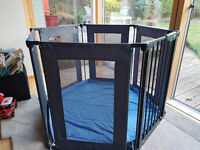 Lindam Safe and secure fabric playpen.