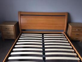 Teak effect king size bed frame.