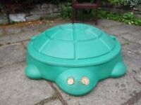 Tortoise shaped Sandpit with lid - this is a used sandpit that is no longer needed