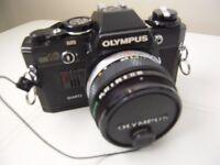 Olympus OM 10 Quartz 35mm SLR Camera + lenses etc.