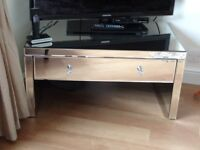 Mirrored coffee table or tv unit, has one drawer