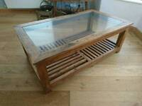 Glass top hardwood coffee table