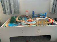 Train table with track and trains