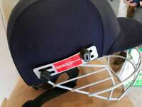 2x cricket helmets and 2x sets of pads