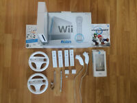 Nintendo Wii incl. 4 Wii-motes, nunchucks, steering wheels and lots of games - ultimate party pack!