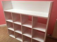 White wooden shelving unit