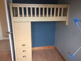 Child's bunk style cot bed with cupboards