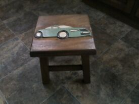 SMALL STOOL WITH UNUSUAL CAR DESIGN ON TOP