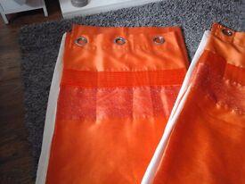 Orange ringtop curtains