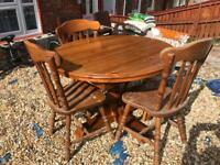 lovely solid wood extendable dining table and chairs