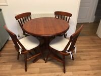 Dark wood round table and 4 chairs