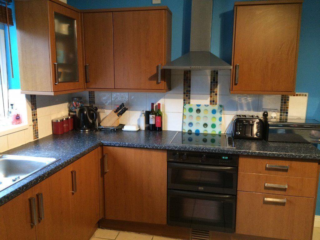 Cherry Effect Kitchen With Black Laminate Worktop 450