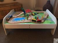 White wooden train table