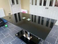 Good quality black glass table