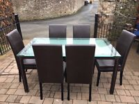 Glass topped table and 6 faux leather chairs with contrast stitching