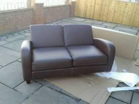 New out of box faux leather 2 seater sofa in Brown only £140