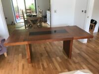 Hardwood dining table with glass inset.