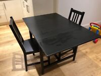 Dining Table and 2 chairs in black/brown wood colour for sale