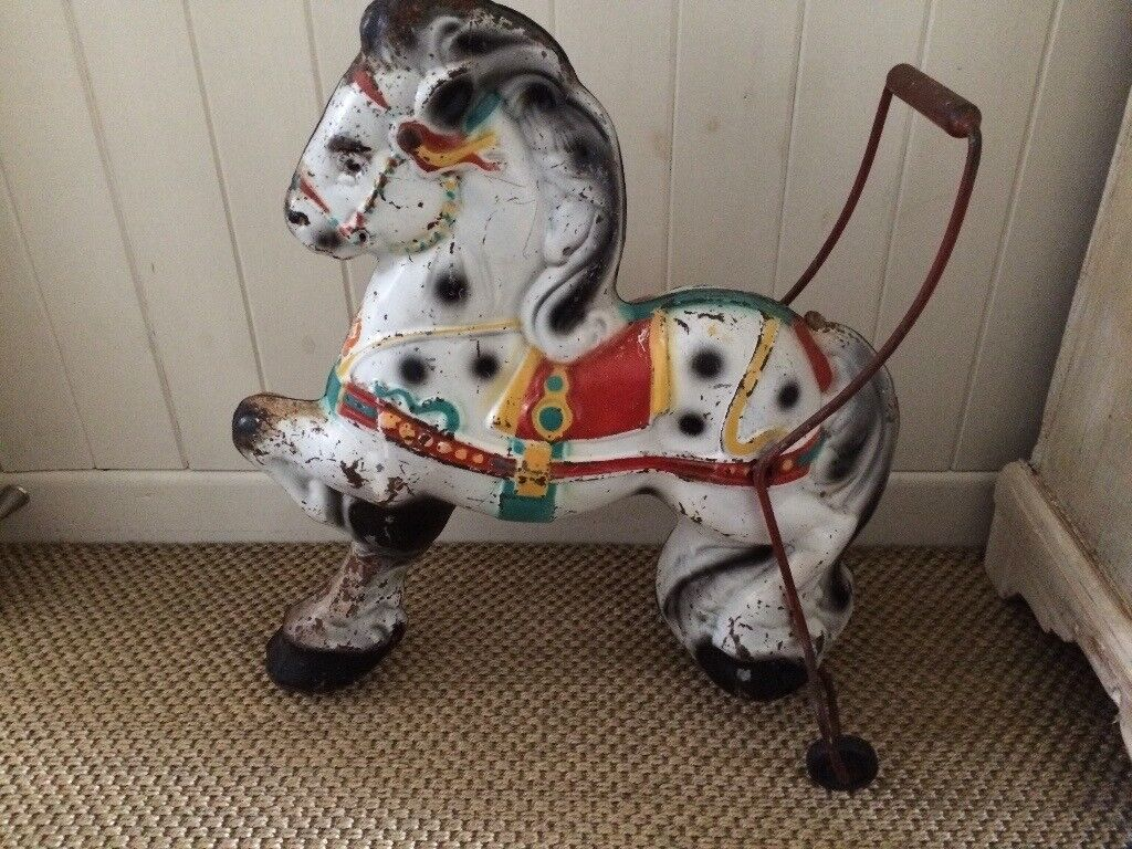 Vintage toy horse on wheels by Triang