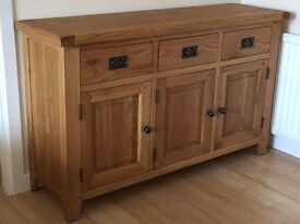 Solid oak sideboard. 3 door and 3 drawer with pewter handles 40cm x 82.5cm x 135cm