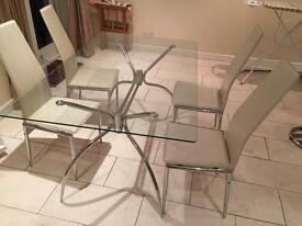 Glass dining room table with 4 leather chairs