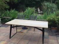 Marble top dining room table 6 seater on matt black metal frame. two years old cost £1300 new.
