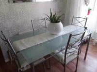 Dining glass table and four chairs