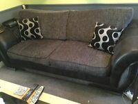 Two x three seater settee's , grey and black