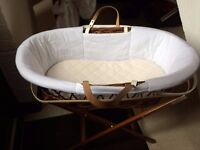 Dark moses basket with white covering and dark stand -in good condition