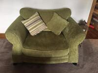 Large green DFS cuddle chair