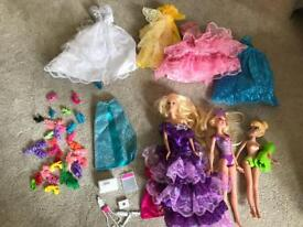 2 Dolls, 1 tinkerbell, several dresses and shoes and barbie car