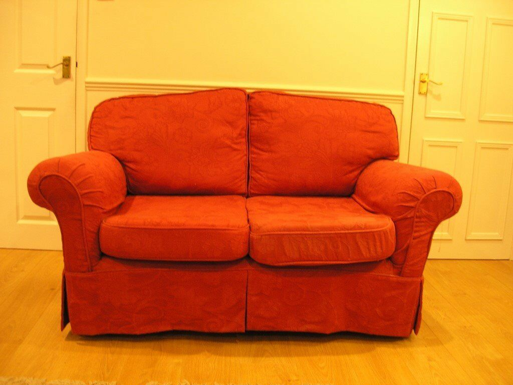 red 2 seater sofa very good condition very little used FREE on collection