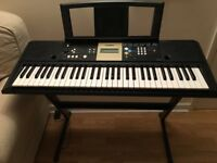 Yamaha YPT-220, featuring teaching tutorial modes, with stand.