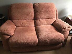 2 x 2-seater dusky pink Furniture Village sofas.