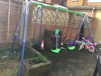 Nearly new swing and seesaw set for 4 kids
