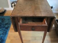 Oak 19 century drop leaf table with pull out draw and 2 oak windsor chaires.