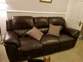 3 piece suite.. brown leather.. immaculate.. from a non smoking no pets home...